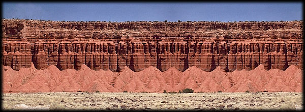 Colorful sandstone cliffs form a picturesque rampart on the Colorado Plateau.